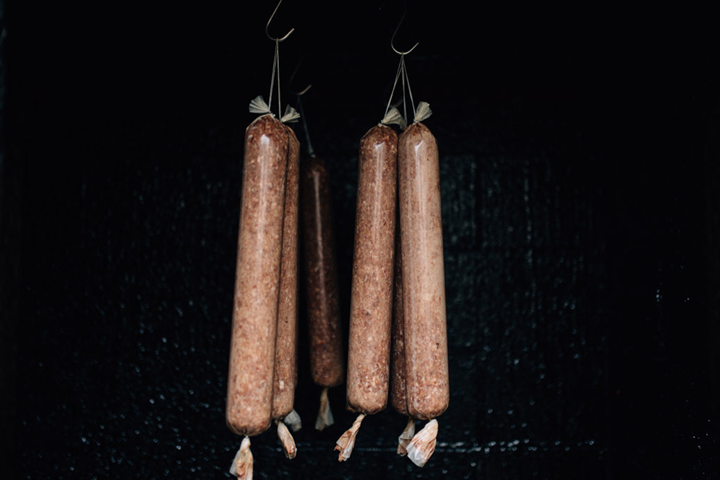 Salamis made from wild pork and venison, cold smoked using manuka in the 50 year old smokehouse at the Outram Butchery.