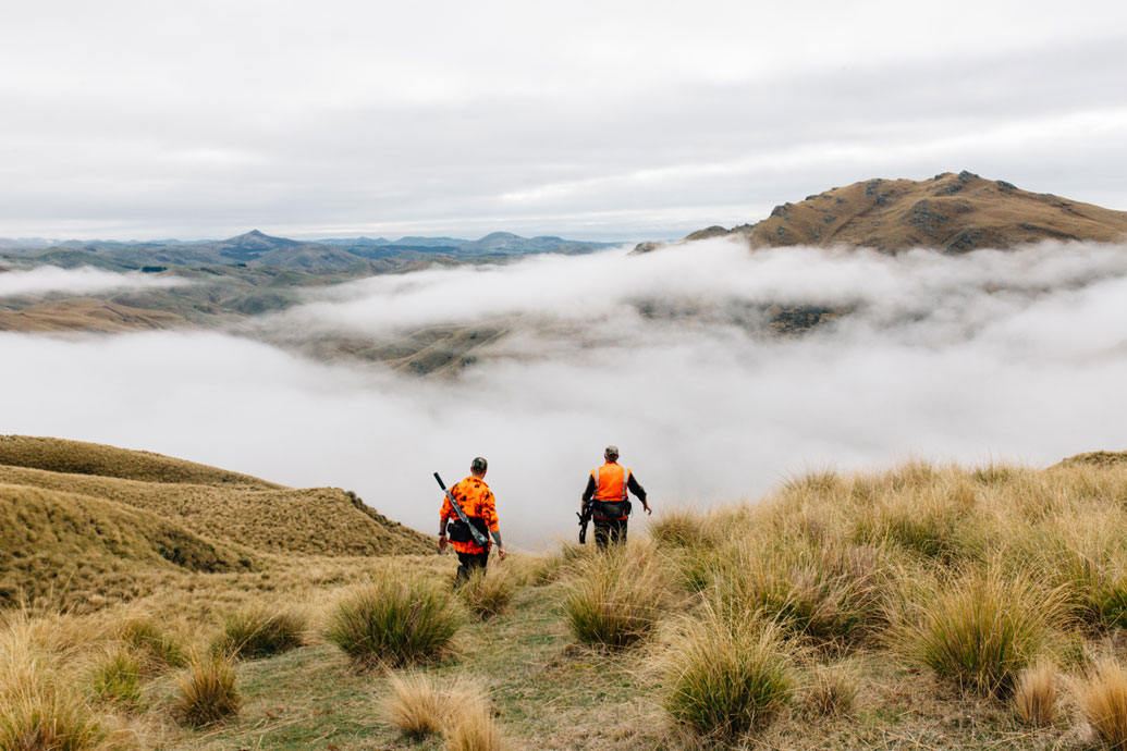 Lyndon Gold and Duane Trafford hunting for wild pigs in the Silverpeaks Range on Dunedin's back doorstep.
