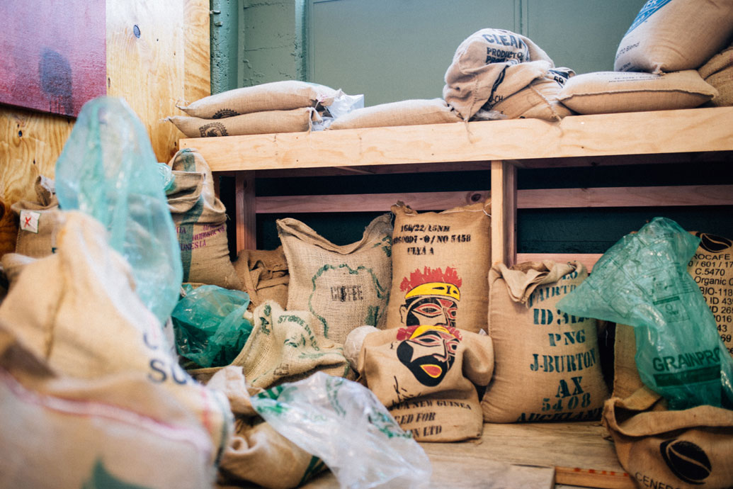 Sacks of coffee beans from all over the world ready for roasting.